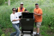 Bear Aware's program coordinator Rachael Roussin with Rossland's public works Bob Williams and Michael Page Pose with the newly