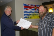 MLA John Slater reviews the mobile abattoir design with Doug Zorn of the agricultural society; Photo, submitted