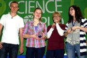 Science Fair organizer Ann McDonnell (second from right) presents the winners with their hardward, from left, Micah May, Emma Borhi, and Miranda Sherell.  — Submitted photo