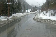 Highway 6 near Whitewater Ski Hill entrance is wet and slippery. — DriveBC photo