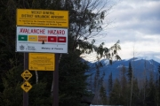 "A sign showing an avalanche hazard warning of ""considerable"" is seen at a parking lot where snowmobilers embark from near Mount Renshaw outside of McBride. — Photo courtesy Huffington Post"