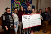 "Members of Rossland Youth Service Group present a cheque to Sheila Adcock and Gail Pighin of ""Getting to Home."""