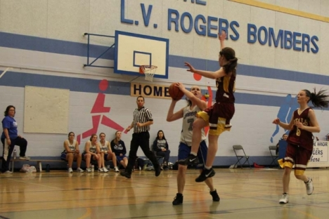 Bomber senior Kiandra McLaren puts a fake on this Rossland Royal player en route to a lay-up during Saturdays final at the Hangar.  Bruce Fuhr photo