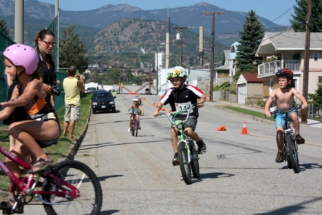 Competitors in the 6-7 age group round the corner on the bike stage during last year's Kids-Tri event in Trail. — submitted photo