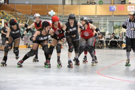 The Oil City Derby Girls (dark uniforms) had a easy time against Deathbridge Saturday morning in consolation action at the NDCC Arena. — Bruce Fuhr photo