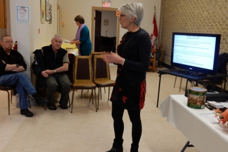 Mayor Kathy Moore introduced consultant Sandi McCreight to a crowded meeting at the Seniors' Hall.
